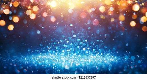 Abstract Glittering - Blue Glitter With Golden Christmas Lights And Shiny sparkling Background
