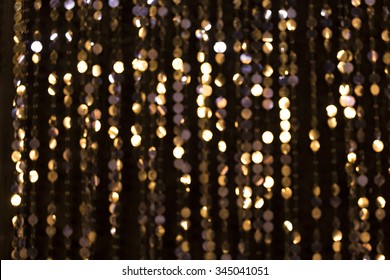 Abstract glittering lights, gold background, a real photo in the blur