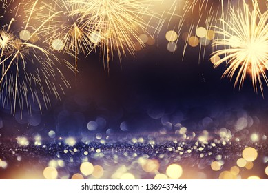 abstract gold, black and blue glitter background with fireworks. New year 2020, 4th of july holiday concept