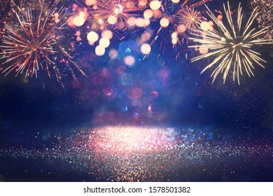 abstract gold, black and blue glitter background with fireworks. christmas eve, 4th of july holiday concept