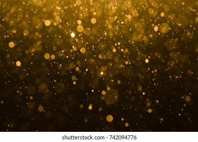 Abstract gold bokeh with black background