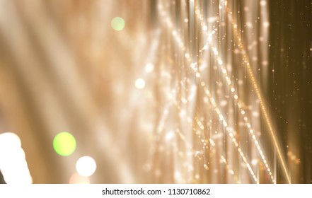 Abstract gold bokeh circles. Beautiful illustration background with particles.
