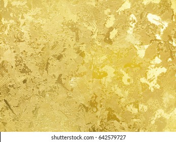 Abstract gold color painted on grunge rough surface of stucco concrete wall. Golden texture background and wallpaper