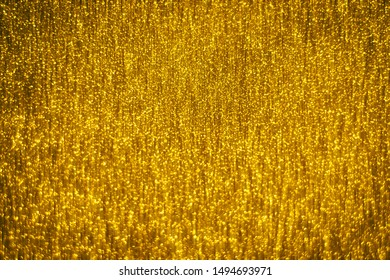 Abstract gold glister defocused background use us gold luxury background for card, flyer, invitation, placard, voucher or banner background
