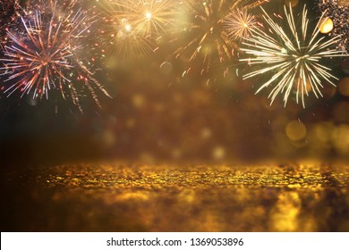 abstract gold glitter background with fireworks. christmas eve, 4th of july holiday concept.
