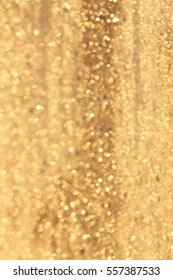 Abstract gold glitter background. Twinkled texture. Bokeh lights.
