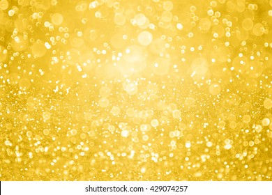Abstract gold glitter sparkle background or golden confetti party invite