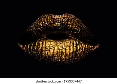 Abstract gold lips. Golden lips closeup. Gold metal art lip. Beautiful makeup. Golden lip gloss on beauty female mouth, closeup. Mouth Icon