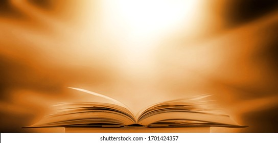 Abstract gold magic book on wooden background