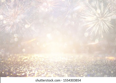 abstract gold and silver glitter background with fireworks. christmas eve, 4th of july holiday concept
