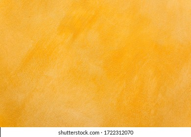 Abstract gold stucco wall texture, plaster yellow pattern background