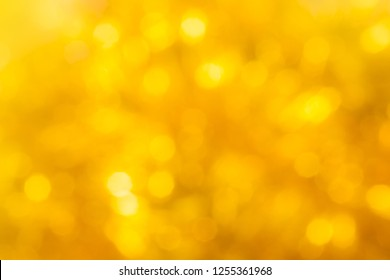 Abstract Gold yellow bokeh background for your design