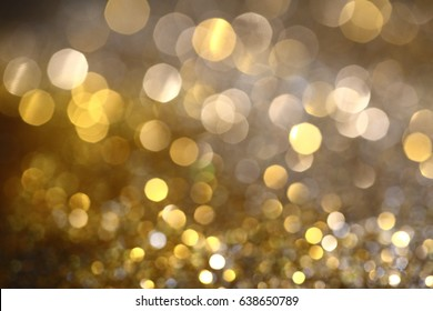 Abstract Golden Bokeh background with shining defocus sparkles. Blurred Glitter Dust Macro close up, copy space for text logo