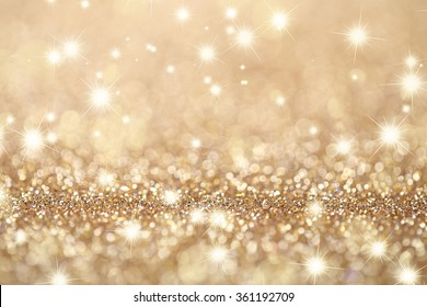 Abstract golden holidays twinkle lights on background.