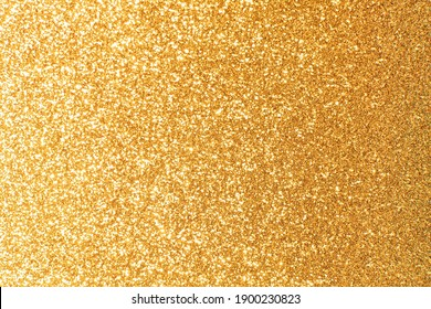 Abstract golden yellow and orange glitter lights background. Circle blurred bokeh. Festive backdrop for Christmas, holiday or event