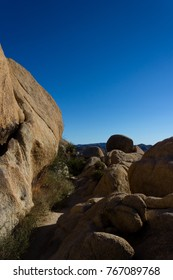 Abstract Granite Rock Formation With Bright Clear Blue Sky Joshu
