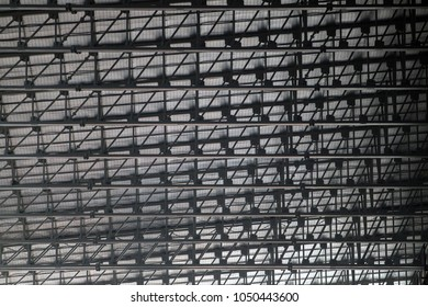 abstract graphic and pattern background created by the surface of roof industrial. metal sheet roof interiors structure of modern building