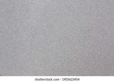 An abstract gray background with blue speckled undertones.