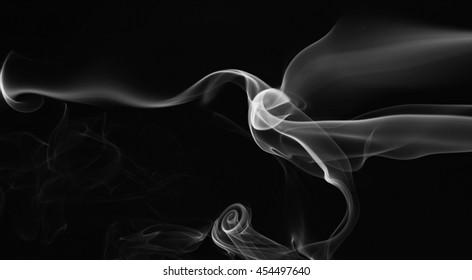 abstract gray smoke swirls isolated on black