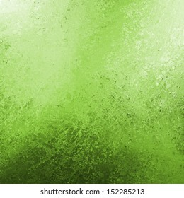 abstract green background or green paper with bright top spotlight and black vignette border frame with vintage grunge background texture lime green layout design for website template or Christmas ad