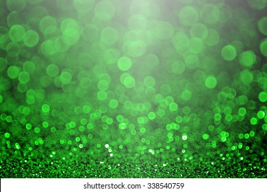 Abstract green and black glitter sparkle background party invitation