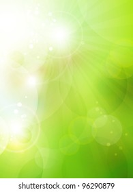 Abstract green blurry background with overlying semitransparent circles, light effects and sun burst. Great spring or green environmental background. Space for your text.  Vector available in my port.