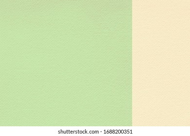 Abstract green and cream pastel  colors felt textured background with copy space for design and decoration. Two tone background fashionable glamorous divided into two parts.