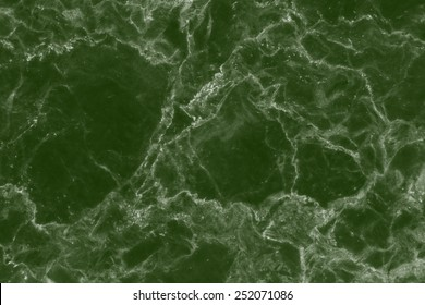 Abstract green marble patterned texture background.