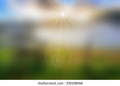 Abstract green nature blurred background with bright sunlight, flare