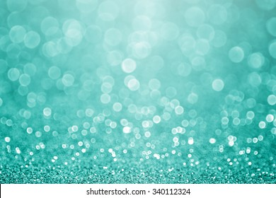 Abstract green teal or turquoise glitter sparkle background or aqua Christmas party invitation