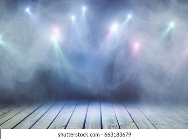 Abstract grey stage with smoke and spot lights. Presentation concept