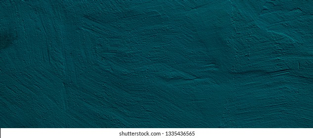 Abstract Grunge Dark Blue Turquoise Stucco Wall Background Close up. Decorative Painted Plaster Surface Texture. Wide Angle Rough Background With Copy Space For design