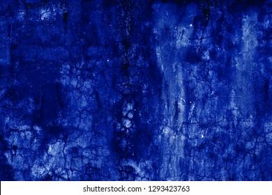 The abstract grunge dark navy background, textured