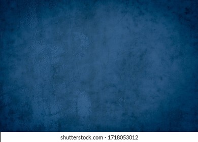 Abstract grunge decor. Beautiful dark blue stucco wall background. Space for designing and inserting text.