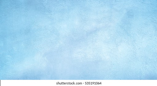 Abstract Grunge Decorative Light Blue Plaster Wall Background with Winter Pattern. Rough Stylized Texture Wide Screen With Copy Space for Design.