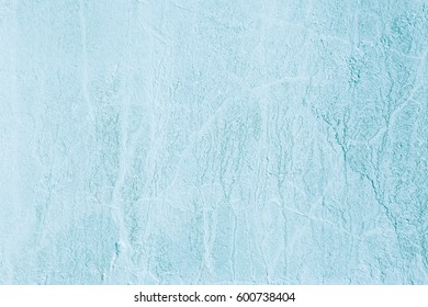 Abstract Grunge Decorative Light Blue Cyan Painted Stucco Wall Texture. Handmade Rough Winter Christmas Concept Background With Copy Space For design