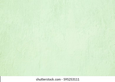 Abstract Grunge Decorative Light Green Painted Stucco Wall Texture. Handmade Rough Art Background With Copy Space For design.
