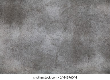 Abstract Grunge grey Stucco Wall Background. Exposed plaster Surface Texture close up. Tough Background With Copy Space for design