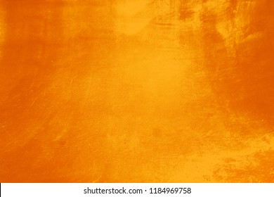 Abstract grunge surface orange gold background golden yellow highlights