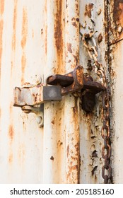 abstract grungy metal surface and lock on rusty iron door