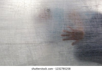 Abstract hand behind obscuring opaque texture in Bangkok Art Biennale 2018, Bangkok, Thailand.