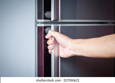 Abstract hand a young man catch a refrigerator door