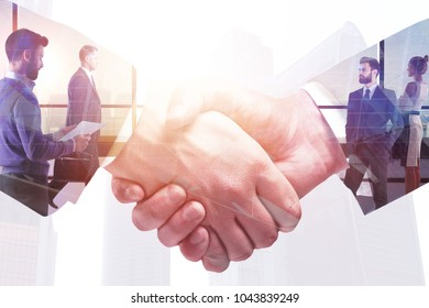 Abstract handshake on meeting city background. Teamwork and finance concept. Double exposure