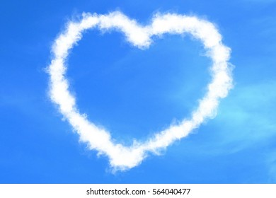 abstract heart shape love draw on the blue sky with white clouds background, valentine day holiday event festive symbol sign concept