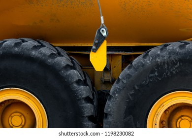 Abstract of heavy duty truck wheels and a yellow body