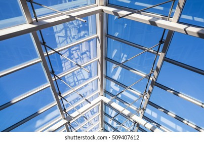 Abstract high-tech architecture background photo, internal structure of glass roof arch with lockable windows sections