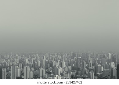 abstract hipster stylized top view foggy big city can use for background with copyspace. black and white vintage fashion style processed