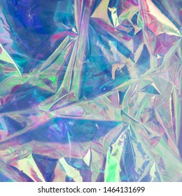 Abstract holographic background in the style of the 80s. Modern design for vaporwave. Neon colors. Iridescent hologram texture
