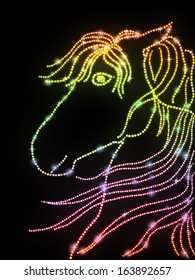 Abstract horse head made from colorful sparkling dots.