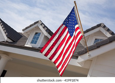 Abstract House Facade & American Flag Against a Blue Sky